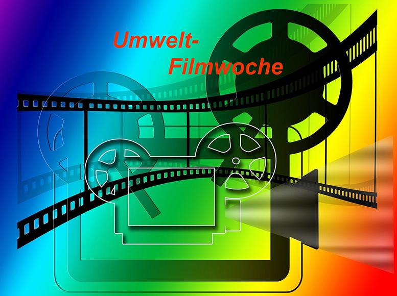 """Eine Grafik - mit Filmrolle, Projektor, Startsymbol - in einem Farbverlauf von Blau über Grün und Gelb bis Rot. Der Schriftzug """"Umwelt-Filmwoche"""" ist zu lesen."""